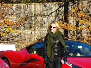 autumn red luxury car on the background